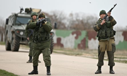 Troops under Russian command fire weapons into the air in Ukraine
