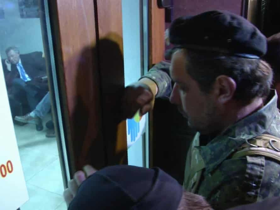 Unidentified men in military fatigues outside a cafe in Simferopol, Ukraine who appear to be stopping UN envoy Robert Serry from leaving.
