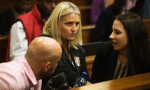 Oscar Pistorius's sister Aimee (far right) talks to some of Reeva's family members during day four of Pistorius's murder trial.