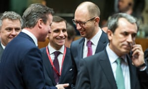 David Cameron speaks with Ukraine's prime minister, Arseniy Yatsenyuk, at the EU summit in Brussels.