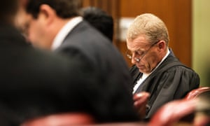 State prosecutor Gerrie Nel, looks at papers during day four of Oscar Pistorius's murder trial in Pretoria.