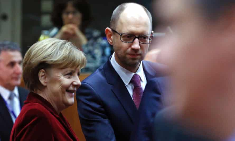 Germany's chancellor Angela Merkel and Ukraine's prime minister Arseniy Yatsenyuk at a European leaders emergency summit in Brussels