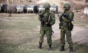 Alleged Russian soldiers in full body armour and armed with assault rifles next to the besieged Ukrainian military base in Perevalnoye close to Simferopol.