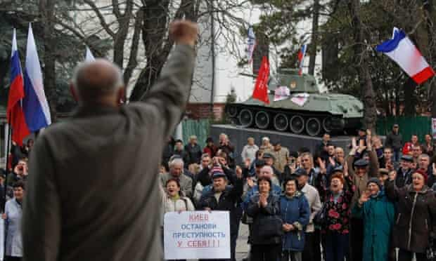 Pro-Russia demonstrators rally at the local parliament building, with a monument of World War II in the background, in Crimea's capital Simferopol, Ukraine, Thursday, March 6, 2014.