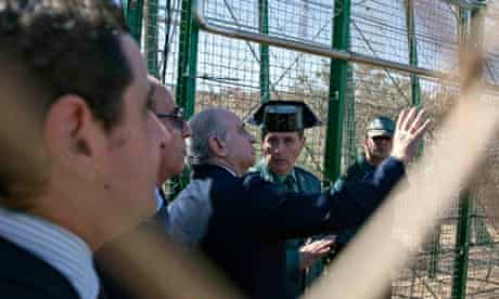 Spain's Interior Jorge Fernández Díaz examines a border