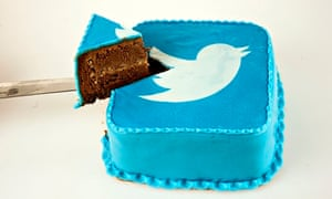 File illustration photo of a person taking slice of cake which is decorated with a Twitter logo