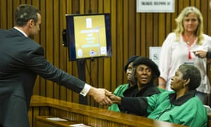 Accused Paralympian Oscar Pistorius extends a hand to members of the ANC's Women's League during a tea break at the high court in Pretoria.