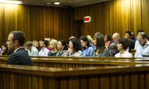 Oscar Pistorius (far left) sits in the dock in front of members of his family, on the fifth day of his murder trial.