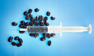 Syringe filled with coffee beans