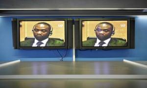 Germain Katanga appears on monitors at the international criminal court