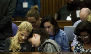 Oscar Pistorius's sister Aimee Pistorius (centre) rests her head on a friend's shoulder on the fifth day of her brother's trial.
