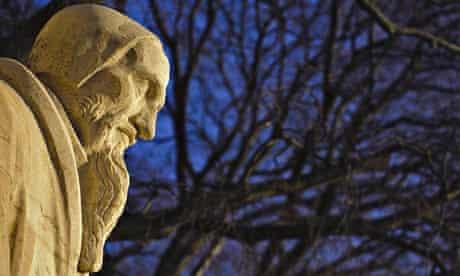 A statue of John Calvin at Geneva's Reformation wall.