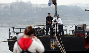 Ukrainian navy personnel use a pulley to get food supplies from their families on their ship blockaded in Sevastopol harbour.