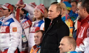 In this photo taken Thursday, March 6, 2014, Russian President Vladimir Putin poses with athletes during his visit to the mountain Paralympic village in Krasnaya Polyana, Russia, on the eve of the opening ceremony of the 2014 Winter Paralympics in Sochi.