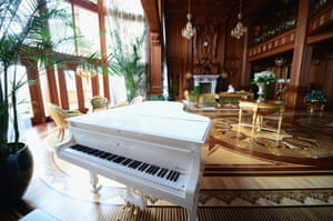 A white Steinway piano sits in a room inside President Viktor Yanukovych's Mezhyhirya estate, which was abandoned by security, on February 26, 2014 in Kiev, Ukraine.