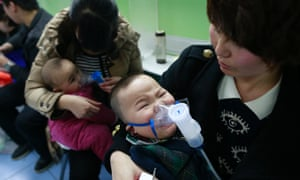 Children with respiratory illness receive treatment at a hospital in Beijing, February 21, 2014.