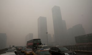 Vehicles clog a highway during a hazy day in Beijing
