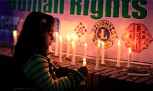 A girl lights candles during a rally to commemorate International Women's Day in Islamabad