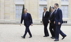 French President Francois Hollande (L) welcomes the head of the Ukrainian UDAR (PUNCH) party Vitali Klitschko (R), the Ukrainian member of parliament and businessman Petro Poroshenko (2nd R), and French author and film director Bernard-Henri Levy prior to a meeting at the Elysee presidential palace in Paris, on March 7, 2014.