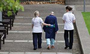 NHS staff with an elderly hospital patient