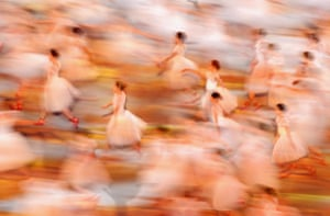 Young ballet dancers perform during the Opening Ceremony.