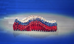 Performers form waves of red white and blue to create an impression of the Russian national flag.