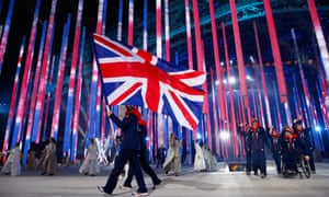 Flying the flag: Great Britain enters the arena lead by flag bearer Millie Knight.