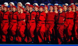 A chorus of red dancers perform during the opening ceremony.