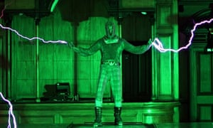 Connected: a performer in a chainmail suit survives a 1m-volt charge of electricty.
