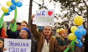 Hundreds of Ukrainian women, and some men, hold a demonstration in support for peace and for keeping Ukraine unified in Bakhchisaray in Crimea.