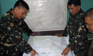 Philippines military personnel plan search and rescue operations for the missing Malaysia Airlines plane at Antonio Bautista air base in Puerto Princesa.