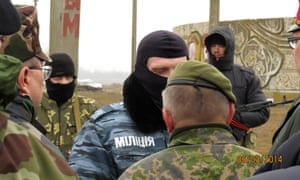 Observers from the Organisation for Security and Co-operation in Europe are stopped from entering Crimea by unidentified soldiers.