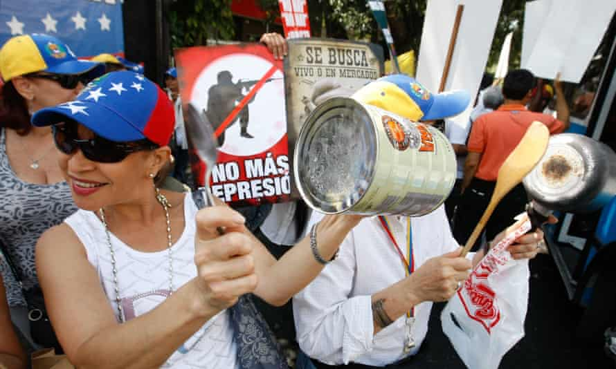 Marchers in Caracas bang pots in protest at food shortages.