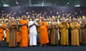 Buddhists hold a special prayer for missing Malaysia Airlines flight at Kuala Lumpur International Airport.