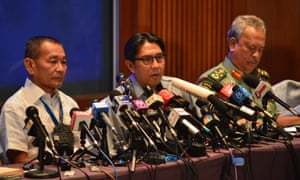 Officials of Malaysia Airlines speak at a press conference in Kuala Lumpur, Malaysia.