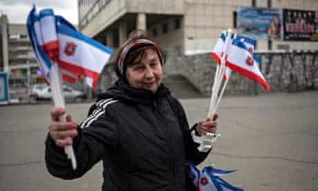 A woman holding Crimean flags in Simferopol
