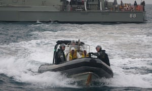 Australian navy personnel transfer Afghanistan asylum-seekers to a Indonesian rescue boat.