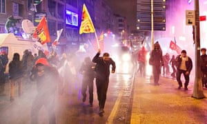 Protesters hit by water cannon and tear gas as they demonstrate against Turkey's PM February 2014