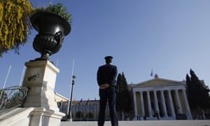 A police officer stands in front of  Zappeion hall during  a Eurogroup meeting, in Athens on Tuesday, April 1, 2014.