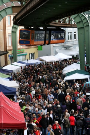 An elevated train passes over a flea market in the Vohwinkel district in the city of Wuppertal, Germany.
