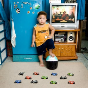 Watcharapon Chookaew, 3  Bangkok, Thailand  Watcharapon loves motorbikes! His father has a scooter and every morning puts his helmet before to leave the house, then he goes out, on the street in front of the house where he keeps his scooter and he goes to work. Watcharapon loves to imitate him e puts the helmet at home, then he plays with his little motorbikes.