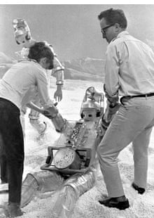 Derek Martinus, right, giving a helping hand to a Cyberman