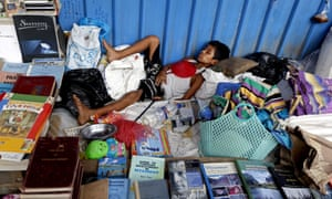 Too many books. Time for a snooze.  EPA/NYEIN CHAN NAING epaselect