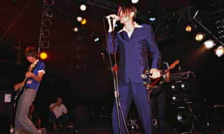 Singer Johnny Dean performs with Britpop band Menswe@r at the Reading Festival in 1995