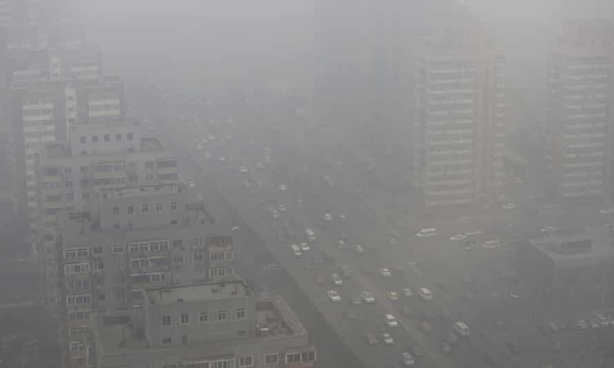 Cars drive on the Three Ring Road amid heavy haze in Beijing in February 2014