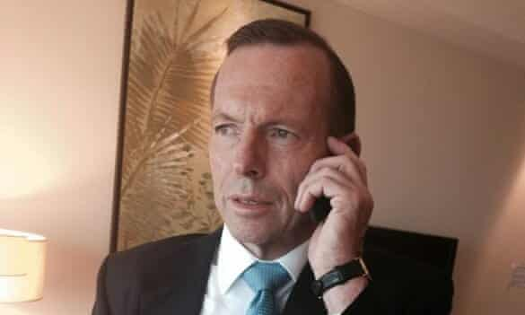 """Tony Abbott tweeted this picture of himself on the phone with the caption: """"Just got an update on the search for #MH370 from JACC Chief Coordinator Air Chief Marshal Angus Houston (Ret'd)""""."""