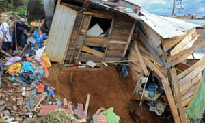 People search for survivors following a landslide in La Gabriela neighbourhood, north of Medellín, following a landslide in December 2010.