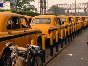 Bike or taxi? A rank of awaiting vehicles in Kolkata.