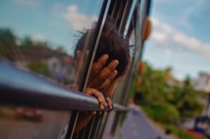 'A child looking out of the bus.'