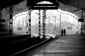'Indian railways is one of the largest networks of trains in the world transporting 10's of millions of passengers daily. This is a shot of a train station along the Mass Rapid Transport System line in Chennai, India'